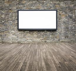 blank advertising billboard on a brick wall
