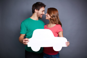 Couple with paper car