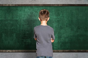 Child in front of empty Blackboard