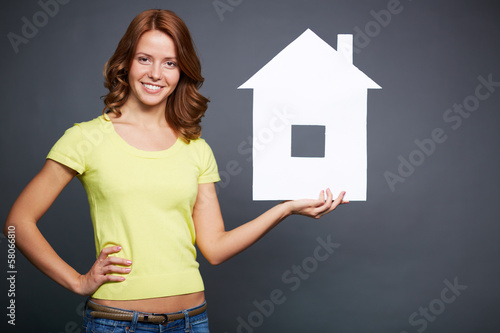 Girl with paper house