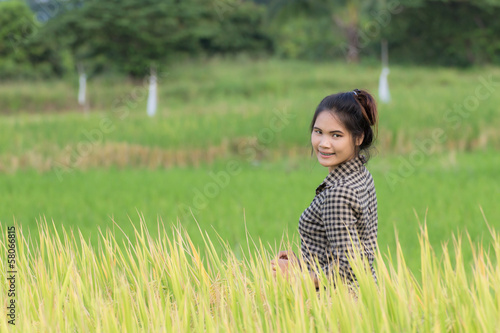 Woman farmer in Green Cornfield