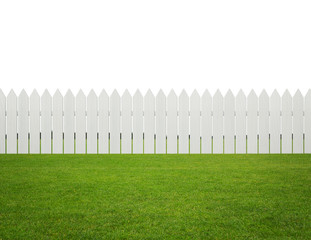 Front or back yard, white wooden fence on the grass
