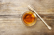 Bowl of honey on wooden table. Symbol of healthy living and natu