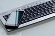 Mobiltelefon auf Tastatur