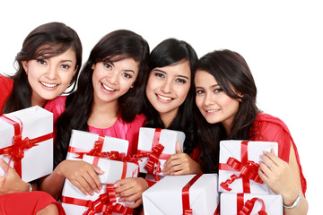 Happy four asian woman with christmas santa hat holding gift box