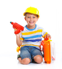 Boy in a helmet plays in the builder
