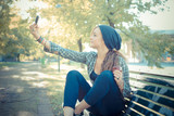 beautiful young blonde hipster woman selfie poster