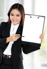 Business woman showing blank clipboard