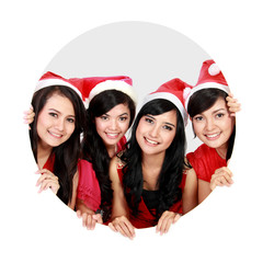 Four asian women with christmas santa hat in circle