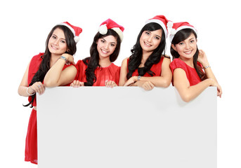 Happy funny people with christmas santa hat holding blank banner