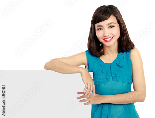 Happy smiling young woman showing blank signboard