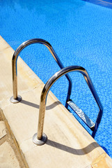 Swimming pool ladder,transparent blue water
