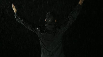 Young Man Raising in Pouring Rain Redemption Concept Religion