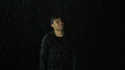 Religious Christian Concept Redemption Purity Young Man in Rain
