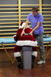 male therapist massaging overworked Santa Claus