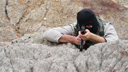 War Terrorist Assasin Anarchist Aiming Shooting Rifle Rocks