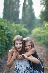 beautiful girls in fall vineyard