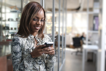 African or black American woman calling or texting cellphone