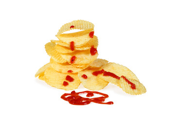 Pile of potato chips with ketchup