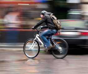 Man on bicycle  in the city. Intentional motion blur