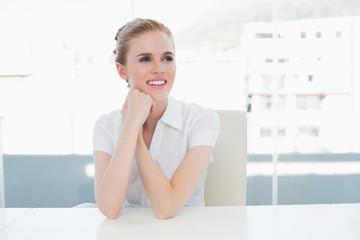 Thoughtful businesswoman sitting office desk