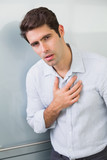 Portrait of a casual young man with chest pain