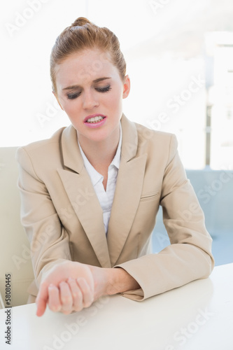 Businesswoman suffering from wrist pain