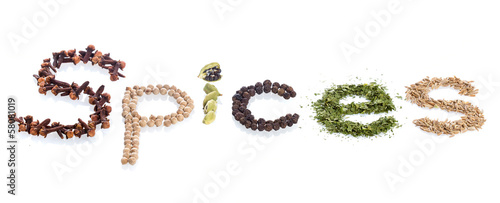 "The ""spices"" word made of various herbs and seeds isolated on wh"