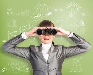 business woman looking through binoculars
