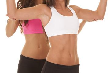 Two women fitness bodies train