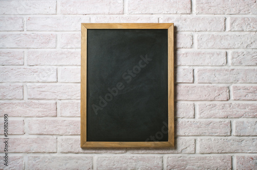 Chalk board on a white brick wall