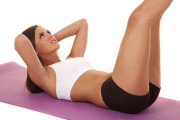 Woman white top fitness crunch close legs up