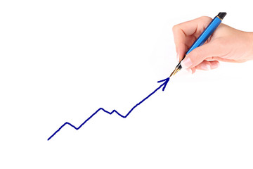 Businessman drawing a growing graph