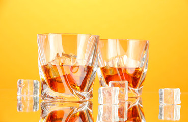 Two glasses of scotch whiskey, on color background