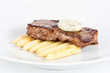 Delicious beef steak on white plate with corn