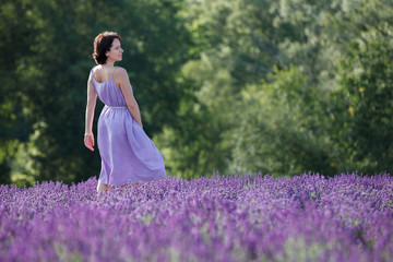 Young woman relaxing in lavender field