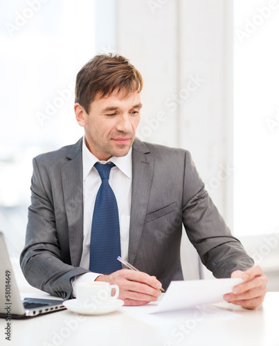 businessman with laptop computer and documents