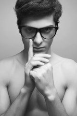Eyewear concept. Handsome muscular male model in trendy glasses