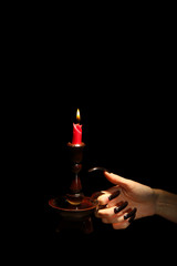 Hand with candle , isolated on black