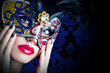 Beautiful model in carnival mask with red lips