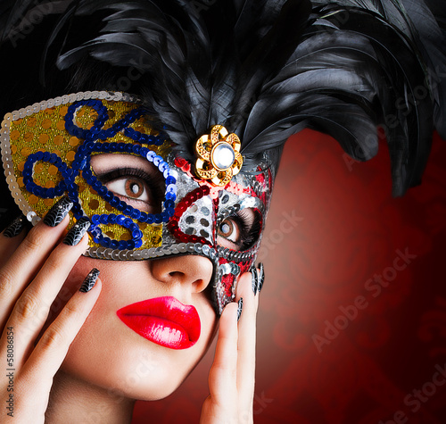 Beautiful model in carnival mask