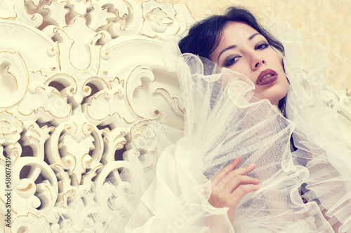 Emotive portrait of beautiful queen like girl in classic style
