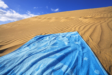 sand dunes and towel