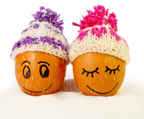 funny lovely  eggs in winter hats and sugar like a snow