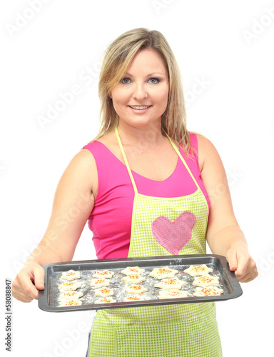 Woman holding tray with  raw cookies isolated on white