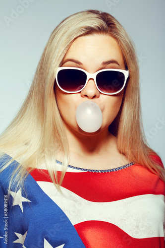 American Mom Concept: Young pregnant woman in trendy eyewear