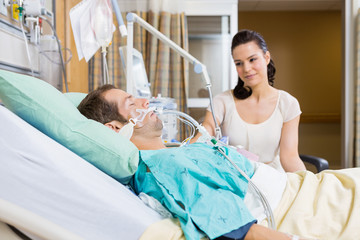 Woman Looking At Man In Hospital