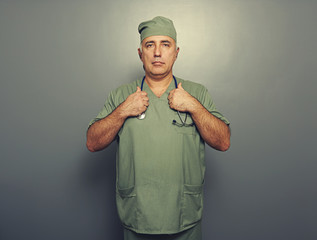 serious man in medical uniform