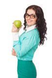 smiling brunette girl in green skirt and blouse holding apple
