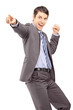 Happy young businessman pointing with his finger and gesturing